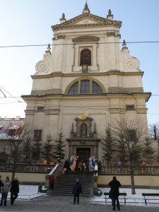 Karin in front of Infant of Prague church at Christmas