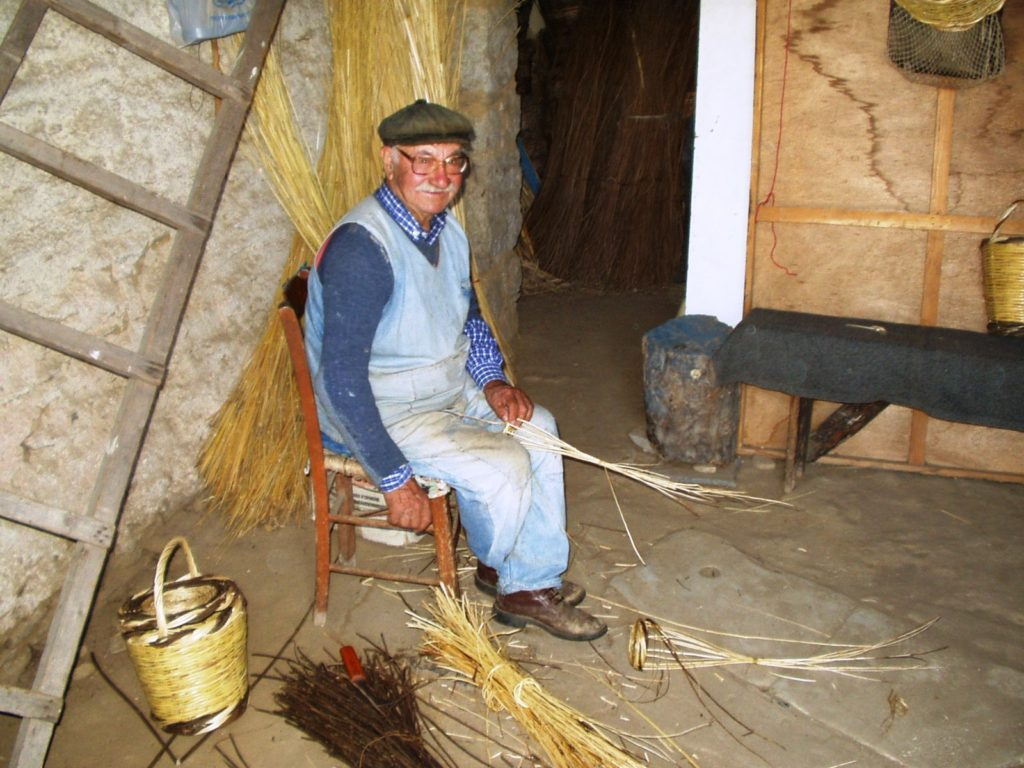old man weaving basket