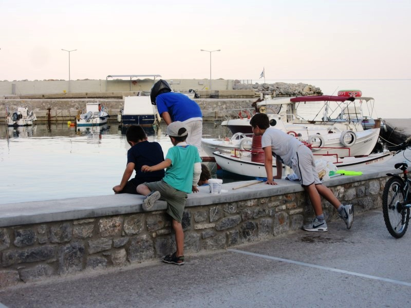 boys fishing at harbour