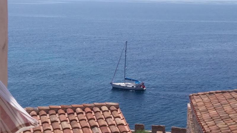 boat passing under balcony at Monamvasia